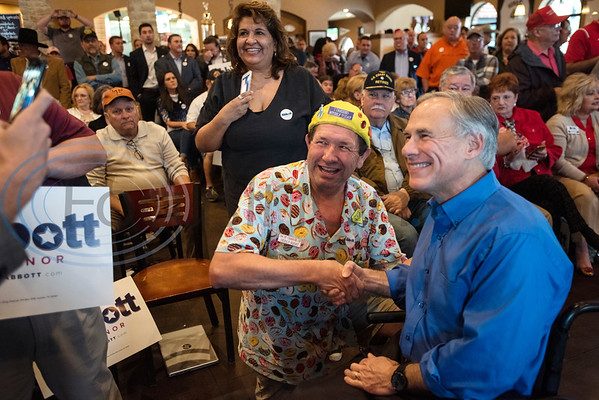 Kornpop McCullough has his photo taken with Texas Gov. Greg Abbott, who is running for re-election, during a campaign event at Bruno's Pizza, 15770 FM 2493 in Tyler on Wednesday Oct. 24, 2018. U.S. Rep. Louie Gohmert, R-Tyler; Texas Sen. Bryan Hughes, R-Mineola; Texas Rep. Matt Schaefer, R-Tyler; and Texas Rep. Cole Hefner, R-Mt. Pleasant, also attended the event to urge Smith County residents to vote Republican.   (Sarah A. Miller/Tyler Morning Telegraph)