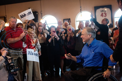 People applaud as Texas Gov. Greg Abbott, who is running for re-election, speaks during a campaign event at Bruno's Pizza, 15770 FM 2493 in Tyler on Wednesday Oct. 24, 2018. U.S. Rep. Louie Gohmert, R-Tyler; Texas Sen. Bryan Hughes, R-Mineola; Texas Rep. Matt Schaefer, R-Tyler; and Texas Rep. Cole Hefner, R-Mt. Pleasant, also attended the event to urge Smith County residents to vote Republican.   (Sarah A. Miller/Tyler Morning Telegraph)