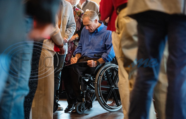 People applaud as Texas Gov. Greg Abbott, who is running for re-election, signs autographs during a campaign event at Bruno's Pizza, 15770 FM 2493 in Tyler on Wednesday Oct. 24, 2018. U.S. Rep. Louie Gohmert, R-Tyler; Texas Sen. Bryan Hughes, R-Mineola; Texas Rep. Matt Schaefer, R-Tyler; and Texas Rep. Cole Hefner, R-Mt. Pleasant, also attended the event to urge Smith County residents to vote Republican.   (Sarah A. Miller/Tyler Morning Telegraph)