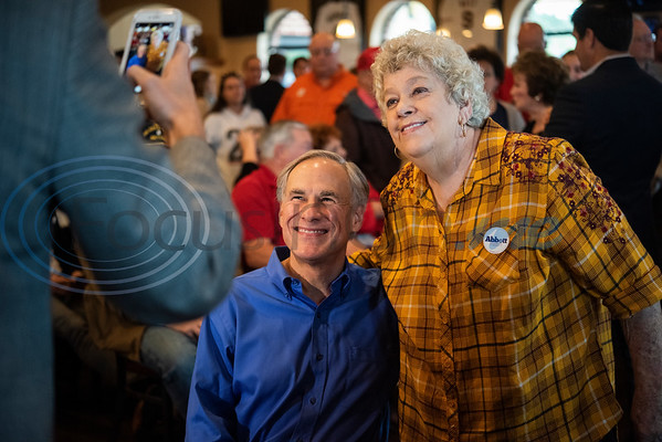 Christie Thomas of Tyler has her photo taken with Texas Gov. Greg Abbott, who is running for re-election, during a campaign event at Bruno's Pizza, 15770 FM 2493 in Tyler on Wednesday Oct. 24, 2018. U.S. Rep. Louie Gohmert, R-Tyler; Texas Sen. Bryan Hughes, R-Mineola; Texas Rep. Matt Schaefer, R-Tyler; and Texas Rep. Cole Hefner, R-Mt. Pleasant, also attended the event to urge Smith County residents to vote Republican.   (Sarah A. Miller/Tyler Morning Telegraph)