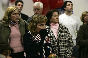 People watch television as Barack Obama is named the President of the  United States at the Republican Headquarters in Santa Clarita, Ca.  Tuesday, November 4, 2008.