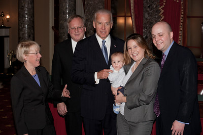 Vice President Joe Biden administered a ceremonial Senate oath during a mock swearing-in ceremony to Senator Patty Murray (D-WA), left, accompanied by husband Robert Murray and other family members, on Jan. 5, 2011, in the Old Senate Chamber on Capitol Hill in Washington DC. (Photo by Jeff Malet)