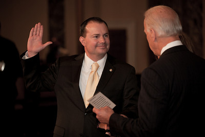 Vice President Joe Biden administers a ceremonial Senate oath during a mock swearing-in ceremony to freshman Mike Lee, on Jan. 5, 2011, in the Old Senate Chamber on Capitol Hill in Washington DC. (Photo by Jeff Malet)