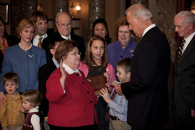 Vice President Joe Biden administers a ceremonial Senate oath during a mock swearing-in ceremony to Senator Barbara A. Mikulski (D-MD), accompanied by members of her family, on Jan. 5, 2011, in the Old Senate Chamber on Capitol Hill in Washington DC. (Photo by Jeff Malet)
