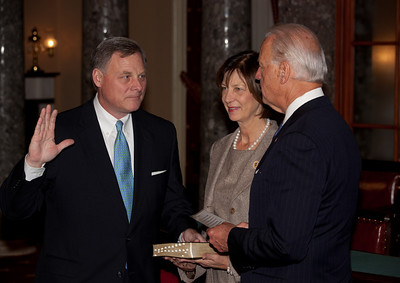 Vice President Joe Biden administers a ceremonial Senate oath during a mock swearing-in ceremony to Senator Richard Burr (R-NC), left, accompanied by wife Brooke Burr, on Jan. 5, 2011, in the Old Senate Chamber on Capitol Hill in Washington DC. (Photo by Jeff Malet)
