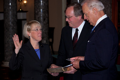 Vice President Joe Biden administered a ceremonial Senate oath during a mock swearing-in ceremony to Senator Patty Murray (D-WA), left, accompanied by husband Robert Murray, on Jan. 5, 2011, in the Old Senate Chamber on Capitol Hill in Washington DC. (Photo by Jeff Malet)