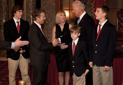 Vice President Joe Biden administered a ceremonial Senate oath during a mock swearing-in ceremony to freshman Rand Paul (R-KY), accompanied by wife Kelly and other family members, on Jan. 5, 2011, in the Old Senate Chamber on Capitol Hill in Washington DC. (Photo by Jeff Malet)