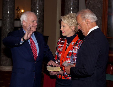 Vice President Joe Biden administers a ceremonial Senate oath during a mock swearing-in ceremony to Senator John McCain (R-AZ), left, accompanied by wife Cindy McCain, on Jan. 5, 2011, in the Old Senate Chamber on Capitol Hill in Washington DC. (Photo by Jeff Malet)