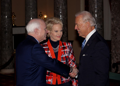 Vice President Joe Biden administered a ceremonial Senate oath during a mock swearing-in ceremony to Senator John McCain (R-AZ), left, accompanied by wife Cindy McCain, on Jan. 5, 2011, in the Old Senate Chamber on Capitol Hill in Washington DC. (Photo by Jeff Malet)