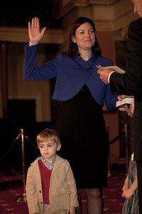 Young Jake Daley waits as Vice President Joe Biden administers a ceremonial Senate oath during a mock swearing-in ceremony to his mother, freshman Senator Kelly Ayotte (R-NH) on Jan. 5, 2011, in the Old Senate Chamber on Capitol Hill in Washington DC. (Photo by Jeff Malet)