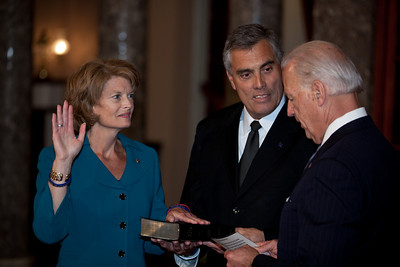 Vice President Joe Biden administers a ceremonial Senate oath during a mock swearing-in ceremony to Senator Lisa Murkowski (R-AK), left, accompanied by husband Verne Martell, on Jan. 5, 2011, in the Old Senate Chamber on Capitol Hill in Washington DC. (Photo by Jeff Malet)