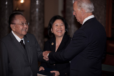 Vice President Joe Biden administers a ceremonial Senate oath during a mock swearing-in ceremony to Senator Daniel K. Inouye (D-HI), left, accompanied by his wife Irene Hirano, on Jan. 5, 2011, in the Old Senate Chamber on Capitol Hill in Washington DC. (Photo by Jeff Malet)