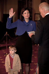 Vice President Joe Biden administers a ceremonial Senate oath during a mock swearing-in ceremony to freshman Senator Kelly Ayotte (R-NH) on Jan. 5, 2011, in the Old Senate Chamber on Capitol Hill in Washington DC. (Photo by Jeff Malet)