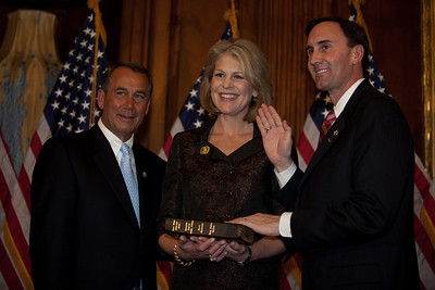 Speaker John Boehner (R-OH), Nancy Olson and Rep. Pete Olson (R-TX). House Speaker John Boehner participates in a ceremonial House swearing-in ceremony for Rep. Pete Olson (R-TX), on Jan. 5, 2011, on Capitol Hill in Washington DC.to a new assignment on the House Energy & Commerce Committee, the House panel with the broadest jurisdiction over non-tax issues of any committee in Congress. That committee will be at the heart of GOP efforts next year to overturn so-called Obama-Care, the sweeping health care overhaul adopted by Democrats. (Photo by Jeff Malet)