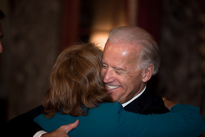 Vice President Joe Biden hugs Senator Lisa Murkowski (R-AK) prior to a ceremonial Senate swearing-in on Jan. 5, 2011, in the Old Senate Chamber on Capitol Hill in Washington DC. (Photo by Jeff Malet)