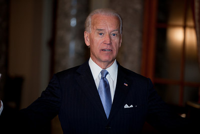 Vice President Joe Biden checks to see if there is anyone else at the conclusion of the ceremonial Senate swearing-in of Senators on Jan. 5, 2011, on Capitol Hill in Washington.  (Photo by Jeff Malet)