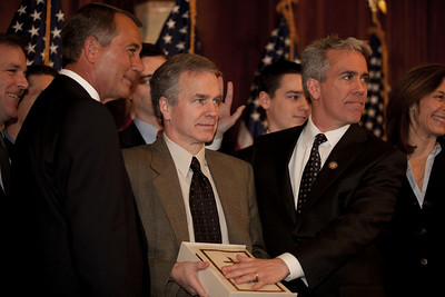 House Speaker John Boehner (R-OH) participates in a ceremonial House swearing-in ceremony for Rep. Joe Walsh (R-IL), on Jan. 5, 2011, on Capitol Hill in Washington DC. In photo, Walsh is on the right with hand over the bible. The Republican Steering Committee of the U.S. House of Representatives has assigned Walsh to three committees: Homeland Security, Small Business, and Oversight and Government Reform.  Walsh will make good on a campaign promise and forgo government provided health care for himself and his wife in protest of the Obama's health care plan in spite of his wife's preexisting condition,  (Photo by Jeff Malet)