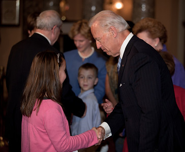 Vice President Joe Biden administered a ceremonial Senate oath during a mock swearing-in ceremony to Senator Barbara A. Mikulski (D-MD), accompanied by members of her family, on Jan. 5, 2011, in the Old Senate Chamber on Capitol Hill in Washington DC. Here Biden chats with Miulski's niece. (Photo by Jeff Malet)
