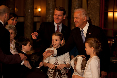 Vice President Joe Biden administered a ceremonial Senate oath during a mock swearing-in ceremony to Senator Michael Bennet (D-CO), accompanied by wife Susan Daggett and other family members, on Jan. 5, 2011, in the Old Senate Chamber on Capitol Hill in Washington DC. (Photo by Jeff Malet)