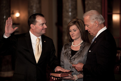 Vice President Joe Biden administers a ceremonial Senate oath during a mock swearing-in ceremony to freshman Mike Lee, left, accompanied by wife Sharon, on Jan. 5, 2011, in the Old Senate Chamber on Capitol Hill in Washington DC. (Photo by Jeff Malet)