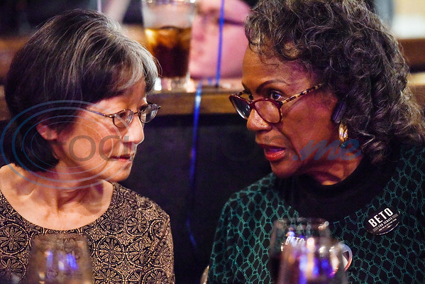 Akemi Henderson and Beverly Beavers-Brooks chat during a midterm election Democratic watch party at Roast Social Kitchen in Tyler, Texas, on Tuesday, Nov. 6, 2018. (Chelsea Purgahn/Tyler Morning Telegraph)