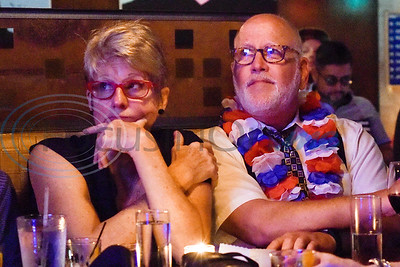 Stasha Gominak and Peter Milne watch election coverage during a midterm election Democratic watch party at Roast Social Kitchen in Tyler, Texas, on Tuesday, Nov. 6, 2018. (Chelsea Purgahn/Tyler Morning Telegraph)