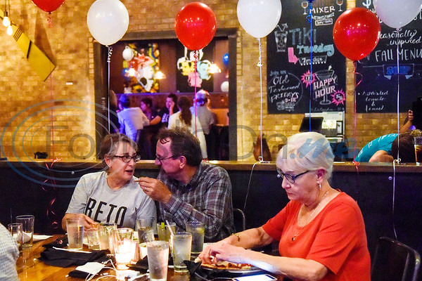 People hang out during a midterm election Democratic watch party at Roast Social Kitchen in Tyler, Texas, on Tuesday, Nov. 6, 2018. (Chelsea Purgahn/Tyler Morning Telegraph)