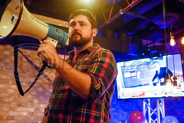 Josh Drake announces that the Texas senate race winning projection has been called for Ted Cruz during a midterm election Democratic watch party at Roast Social Kitchen in Tyler, Texas, on Tuesday, Nov. 6, 2018. (Chelsea Purgahn/Tyler Morning Telegraph)