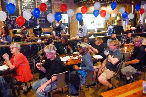 People hang out and watch election coverage during a midterm election Democratic watch party at Roast Social Kitchen in Tyler, Texas, on Tuesday, Nov. 6, 2018. (Chelsea Purgahn/Tyler Morning Telegraph)