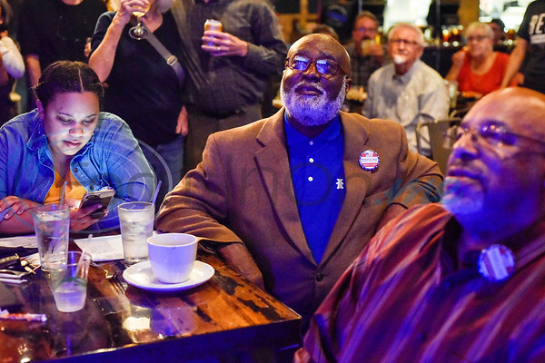 Smith County Judge candidate Michael Mast, center, watches election coverage during a midterm election Democratic watch party at Roast Social Kitchen in Tyler, Texas, on Tuesday, Nov. 6, 2018. (Chelsea Purgahn/Tyler Morning Telegraph)