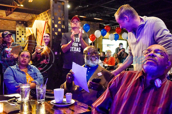 Smith County Judge candidate Michael Mast, center, and others hang out and watch election coverage during a midterm election Democratic watch party at Roast Social Kitchen in Tyler, Texas, on Tuesday, Nov. 6, 2018. (Chelsea Purgahn/Tyler Morning Telegraph)