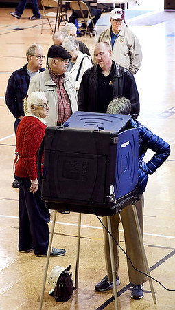John P. Cleary   The Herald Bulletin<br /> Voters wait in line for an open voting machine Tuesday morning at Union Twp., precinct 9 at Bethany Christian Church.