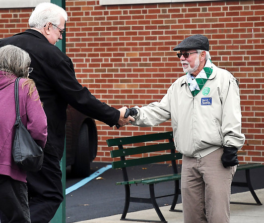 John P. Cleary | The Herald Bulletin<br /> Democrat candidate for State Senator District 25, Tim Lanane, right, greets voters Tuesday morning at Mill Creek Civic Center in Chesterfield.