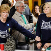 Don Knight | The Herald Bulletin<br /> Sally Devoe, left, reaches out to State Representative Terri Austin as the results of her race are announced at Democratic Headquarters on Tuesday. Austin didn't celebrate her win as Democrats faired poorly in several local races.