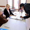 Don Knight | The Herald Bulletin<br /> Tony Dalton signs the poll book as from left Donna Fosnot and Becky Trueblood look on at Redbud estates on Election Day.