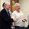 John P. Cleary | The Herald Bulletin<br /> Republican Michael Shively, right, gets congratulations from Jerry Alexander after shively was named the winner for the Anderson Township Trustee position.