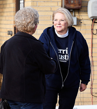 John P. Cleary | The Herald Bulletin<br /> Terri Austin, Democrat candidate for State Rep. District 36, greets voters Tuesday afternoon at the National Guard Armory where three ward 1 precincts vote.