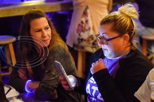 Amanda Spillman looks at Ashley Anderson as she checks her phone during a midterm election watch party for independent candidate Neal Katz at Stanley's Famous Barbecue in Tyler, Texas, on Tuesday, Nov. 6, 2018. (Chelsea Purgahn/Tyler Morning Telegraph)