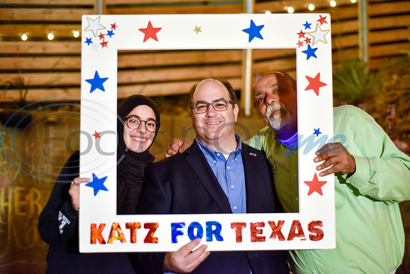 Yasmeen Khalifa, Neal Katz and Anwar Khalifa take a photo with a frame during a midterm election watch party for independent candidate Neal Katz at Stanley's Famous Barbecue in Tyler, Texas, on Tuesday, Nov. 6, 2018. (Chelsea Purgahn/Tyler Morning Telegraph)