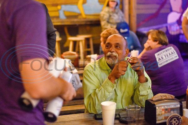 Anwar Khalifa sits as he chats with others during a midterm election watch party for independent candidate Neal Katz at Stanley's Famous Barbecue in Tyler, Texas, on Tuesday, Nov. 6, 2018. (Chelsea Purgahn/Tyler Morning Telegraph)
