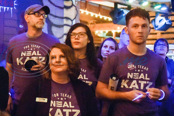 Jen Katz, second from left, and others listen as her husband Neal Katz, not pictured, shares his thoughts about the campaign during a midterm election watch party for independent candidate Neal Katz at Stanley's Famous Barbecue in Tyler, Texas, on Tuesday, Nov. 6, 2018. (Chelsea Purgahn/Tyler Morning Telegraph)