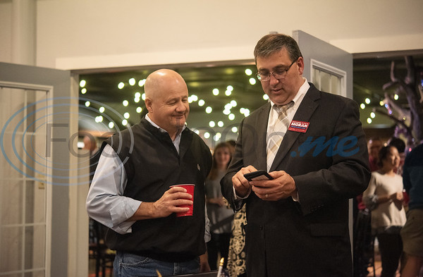 Smith County Commissioner for Precinct 1 Jeff Warr and Smith County Judge Nathaniel Moran attend the Republican election watch party held at the Potpourri House in Tyler on Tuesday Nov. 6, 2018.  (Sarah A. Miller/Tyler Morning Telegraph)