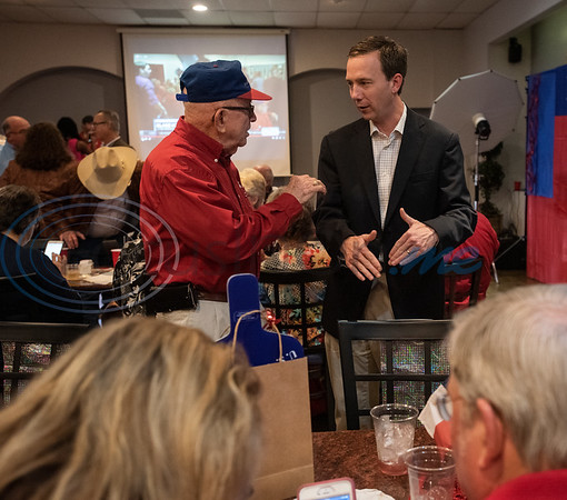 George Winn, president of Smith County Republicans, talks with Taylor Heaton Smith, candidate for Judge of Smith County Court at Law No. 2 during the Republican election watch party held at the Potpourri House in Tyler on Tuesday Nov. 6, 2018.  (Sarah A. Miller/Tyler Morning Telegraph)