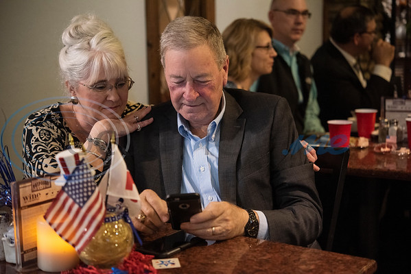 Janet and John Tanner of Hawkins watch election results online on their phone during the Republican election watch party held at the Potpourri House in Tyler on Tuesday Nov. 6, 2018. John Tanner is a District Field Representative for Congressman Louie Gohmert.  (Sarah A. Miller/Tyler Morning Telegraph)