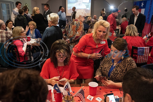 Kristie Antonick, Heather Stoner and Courtney Smith look on their phones online for election results during the Republican election watch party held at the Potpourri House in Tyler on Tuesday Nov. 6, 2018. Stoner is president of Smith County Republican Women and Antonick and Smith are with the new Rusk County Republican Women organization.  (Sarah A. Miller/Tyler Morning Telegraph)