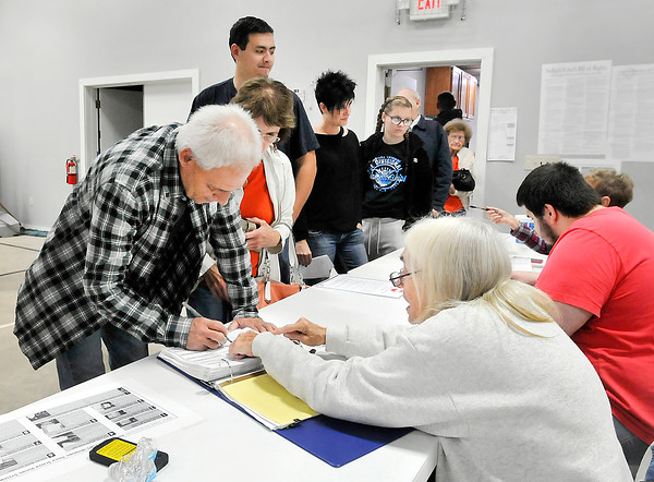 John P. Cleary |  The Herald Bulletin<br /> Lines of voters waited to check in and sign the polling book to vote at Lafayette 2 at Florida Station Church of God Tuesday afternoon.