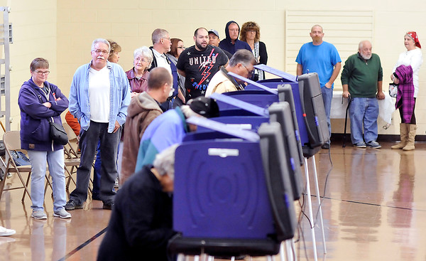 John P. Cleary |  The Herald Bulletin<br /> Voters wait in line for an open voting machine at Union 4 located at Mill Creek Civic Center in Chesterfield Tuesday morning. Poll worked said the line was 15-20 people deep all morning.