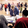 John P. Cleary |  The Herald Bulletin<br /> One more voter for the line.  This voter signs the polling book as the long line to vote in Union 2 is behind her.