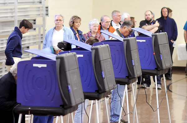 John P. Cleary |  The Herald Bulletin<br /> Voters wait in line for an open voting machine at Union 4 located at Mill Creek Civic Center in Chesterfield Tuesday morning.