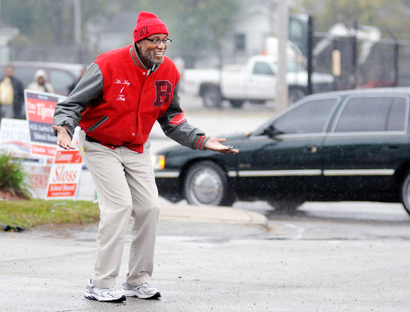 Don Knight | The Herald Bulletin<br /> Anderson school board candidate Terry May jokes with a voter as they leave the polls at the Anderson Zion Baptist Church on Tuesday.